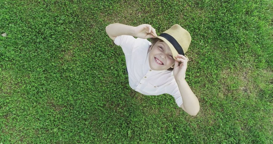 The Portraitist - 2018 EyeEm Awards Relaxation Child Lying Down Portrait High Angle View Directly Above Grass Green Color A New Beginning