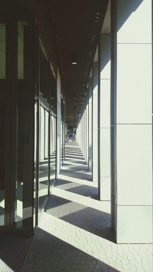 Symetry Vanishing Point Reflection Building Exterior Corridor Shadow Shade Sun Collumns Streetphotography