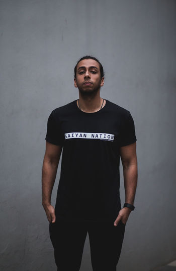 Saiyan Nation (I) Front View One Person Standing Three Quarter Length Young Adult Casual Clothing Young Men Looking At Camera Real People Portrait Wall - Building Feature Beautiful People Contemplation Lifestyles Leisure Activity Fashion Urban athleisure The Portraitist - 2019 EyeEm Awards