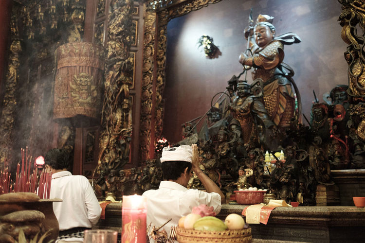 Benoa, Bali, Indonesia - January 28, 2017 : People praying and wishing a happy chinese new year on vihara satya dharma. Altar Architecture Art And Craft Belief Building Built Structure Group Of People Human Representation Male Likeness People Place Of Worship Praying Real People Religion Representation Sculpture Spirituality Statue