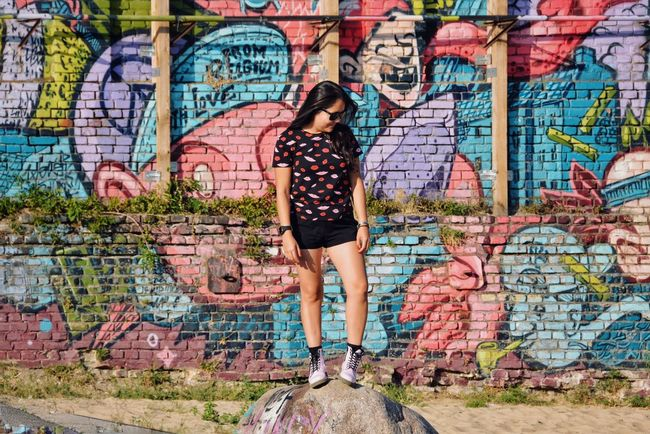 Me and the city I live in. Street Fashion Style Street Art Fashion Graffiti One Person Full Length Wall - Building Feature Architecture Creativity Casual Clothing Street Art Young Women Lifestyles Real People Wall Standing Women Multi Colored Brick