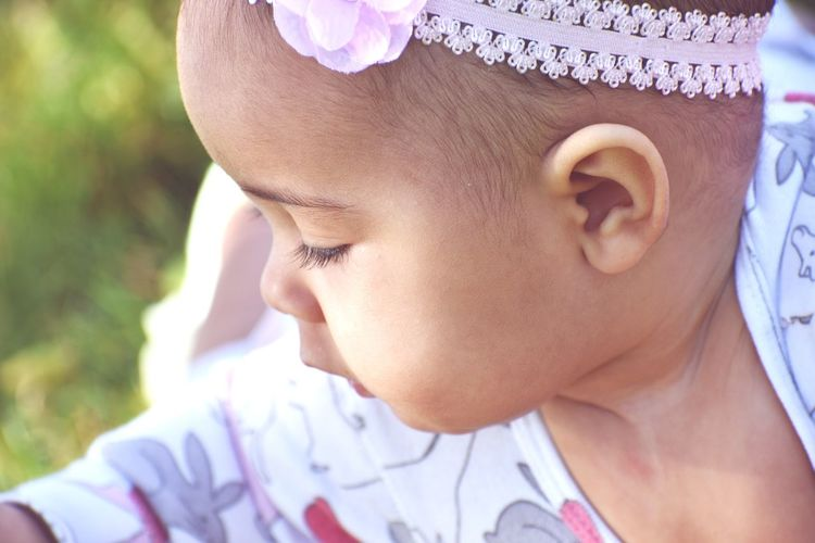 Close-Up Of Cute Baby Girl Wearing Headband