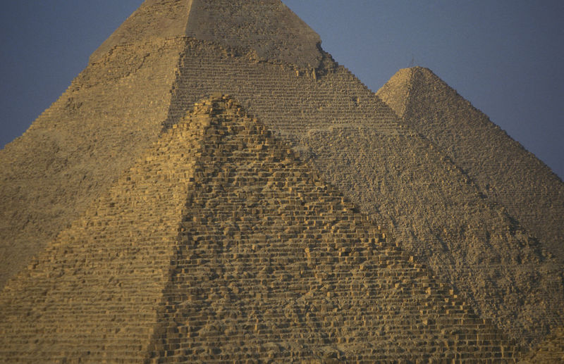 Pyramids of giza against clear blue sky
