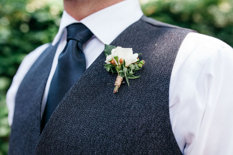 Close-up of well-dressed man wearing corsage