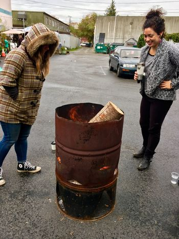 Outdoors Raining In Seattle ArtWork Firewood Barrel Of Fire 55 Gallon Barrel Seattle Gamble People Women Who Inspire You WomeninBusiness Creativity Standing Woman At Work Womenpower Hot Woman Of EyeEm Real People Check This Out Trailer Park Mall Georgetown In Seattle Fun Fall Day Friends