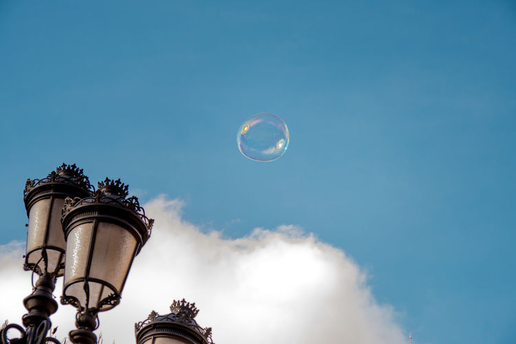 Fliying bubbles in Plaza de España Abstract Photography Blue Sky Bubble Cloud Cloud - Sky Day Lamppost Low Angle View Madrid Spain Minimalism No People Outdoors Plaza De España, Madrid Sky Streetlight Adapted To The City