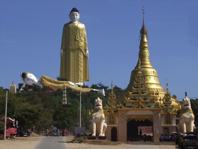 Closer View of Bodi Tataung Giant Pagodas Animal Representation Blue Sky Bodi Tataung Giant Buddhas Buddhism Buddhist Culture Buddhist Stupa Composition Famous Place Full Frame Giant Buddha Gold Coloured Human Representation Monywa Myanmar Outdoor Photography Place Of Pilgrimage Place Of Prayer Place Of Worship Reclining Buddha Religion Standing Standing Buddha Sunlight And Shadow Travel Destination Two Lions
