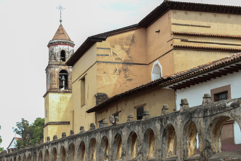 Low angle view of old catholic church