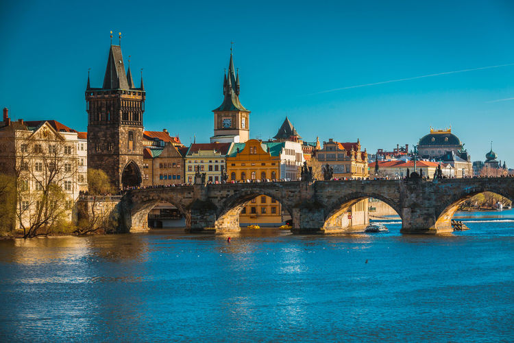 Arch Architecture Blue Bridge - Man Made Structure Building Exterior Built Structure City Connection Day Nature No People Outdoors Prague River Sky Water Waterfront