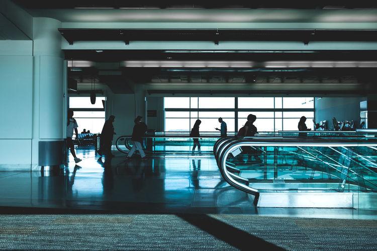 People walking at airport terminal