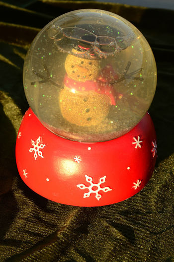 vintage glass and wood snow globe with snowman figure inside Snow ❄ Bauble Celebration Christmas Christmas Decoration Christmas Ornament Christmas Tree Close-up Day Decoration Freshness Indoors  Kinetic No People Red Snow Globe Snowman Tradition