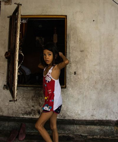 A girl living in Manila North Cemetery, 2016. Photo by Olga Mihova Asian Girl Children Photography Documentary Everydayphilippines EyeEm Gallery Philippines Photojournalism Street Streetphotography Travel