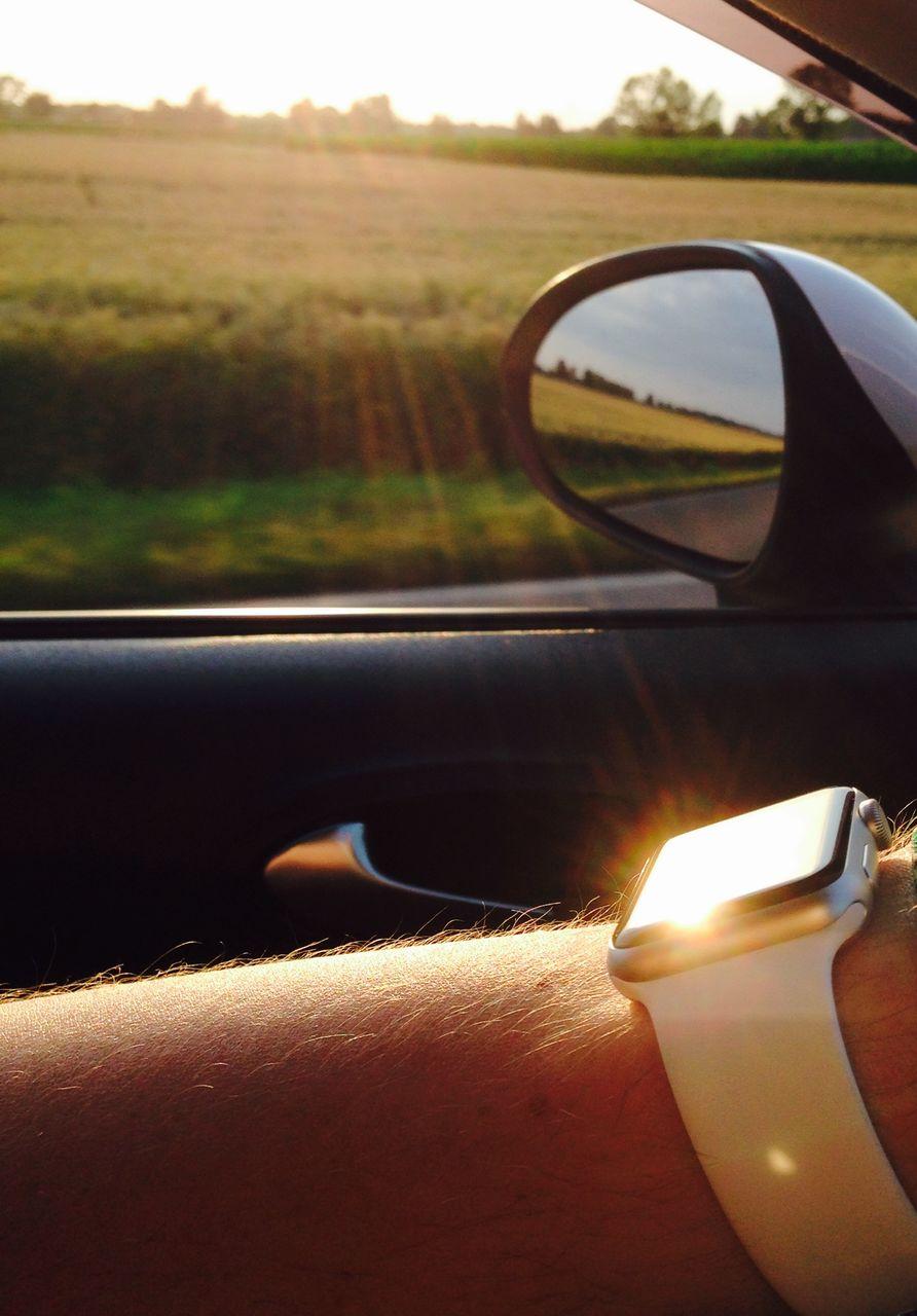 Cropped Hand Of Man Wearing Wristwatch In Car