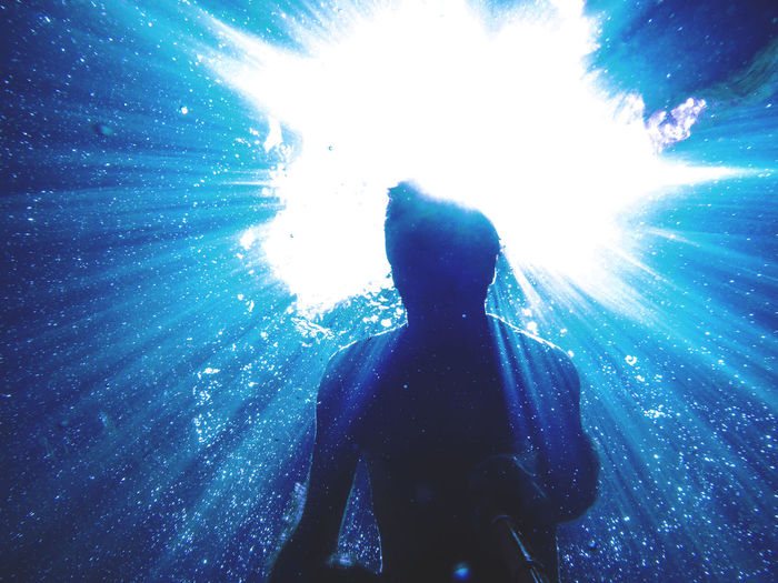 Underwater One Person Sea Lifestyles Water Swimming Blue UnderSea Rear View Adventure Low Angle View Outdoors Exploration Underwater Diving Nature Shining Rays Of Light Shadows & Lights Silhouette Bubbles Shiny Ocean View Ocean Outdoor Photography Blue Sea Capture Tomorrow
