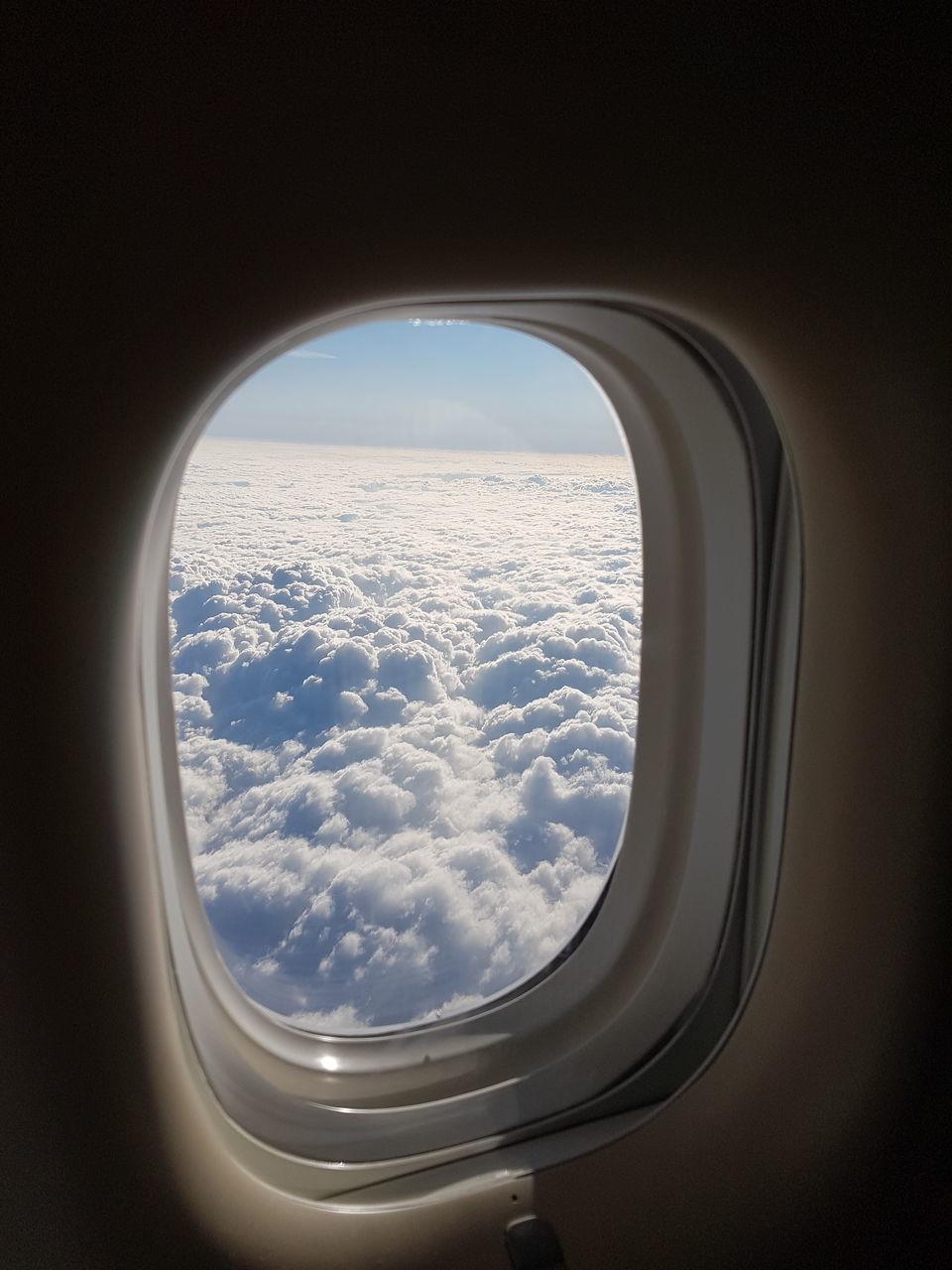 SEASCAPE SEEN THROUGH AIRPLANE WINDOW