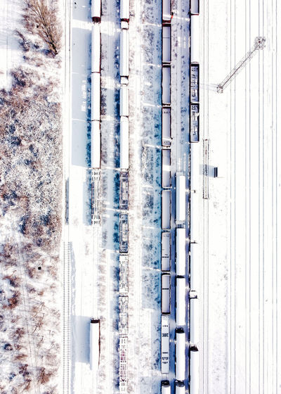 High angle view of vehicles on road during winter