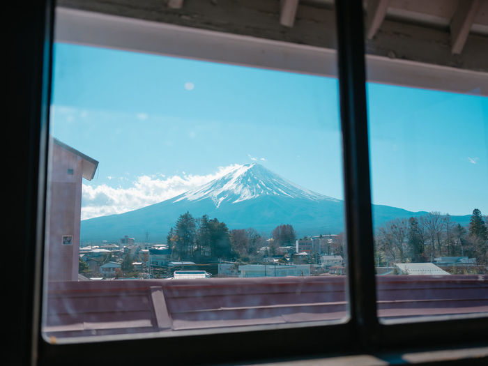 Window Transparent Glass - Material Mountain Sky Nature Snow Vehicle Interior Indoors  Cold Temperature Day Looking Through Window No People Reflection Mountain Range Winter Snowcapped Mountain Focus On Background Cloud - Sky Glass