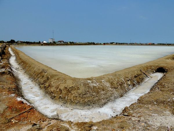 Making salt from sea water on the field ASIA Backgrounds Blue Business Coast Crystal Day Evaporation Lake Mineral Nature No People Outdoor Outdoors Outside Saline Saline Lake Salt Sea Soil Summer Thailand Travel Water White