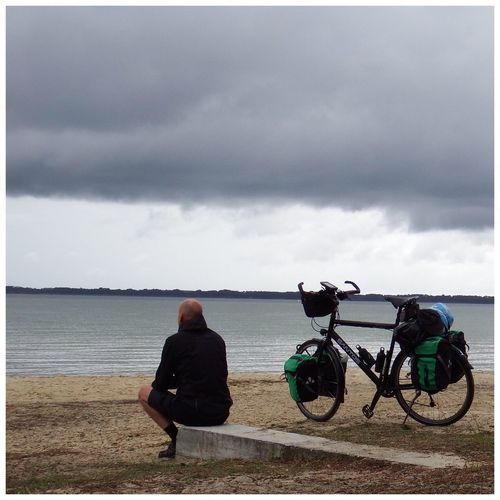 Cloud - Sky Sky Water Real People Sea Lifestyles Rear View Sitting Men Bicycle Outdoors People Nature