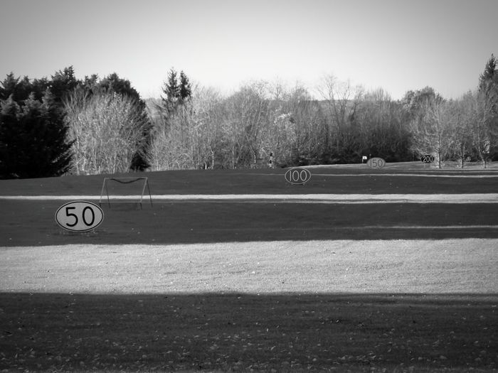 Grey Golf Course Golf Course Alternate Illuminate Lawn Golf Lawn Golf Theme Golf Distance Panels Grass Autumn Trees Numbers And Ovals Sunlight Sport Shadow Golf Panorama Golf ⛳ Black And White Vignette Bnw1 Filter Black And White Photography EyeEm App In Bellefontaine, France