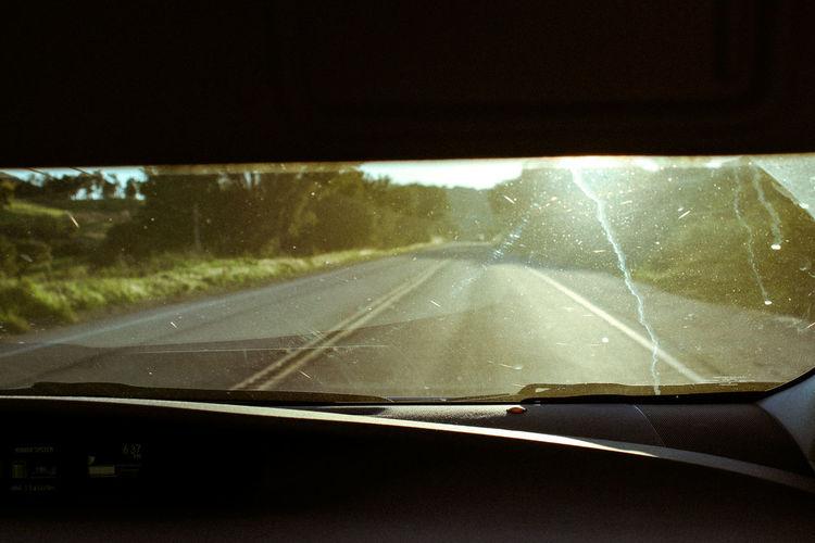 Road seen through car window