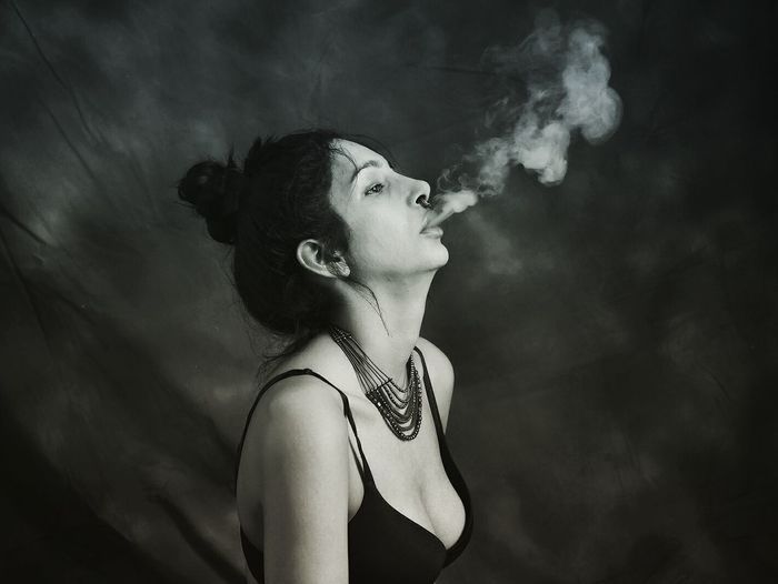 EyeEmNewHere Only Women One Woman Only Adults Only One Person Adult Profile View People One Young Woman Only Smoking - Activity Young Adult Side View Human Face Studio Shot Young Women Human Body Part Indoors  Black Background Close-up The Fashion Photographer - 2018 EyeEm Awards