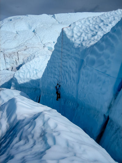 High angle view of person ice climbing