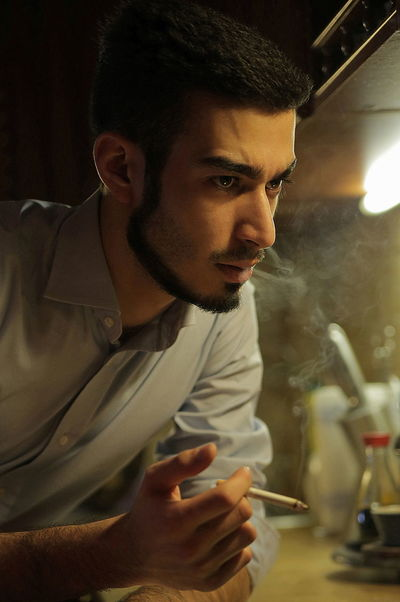 Arabian Problems Smoking Men Fashion Serious Seriousface Arab Kitchen Life Home Interior Heavy Thoughts Leisure Activity Men Men Style Cigarette  Overthinking Stress Stress Reliever Thoughts Well-dressed Anger Young Men Problem Handsome