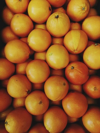 High angle view of oranges in market for sale