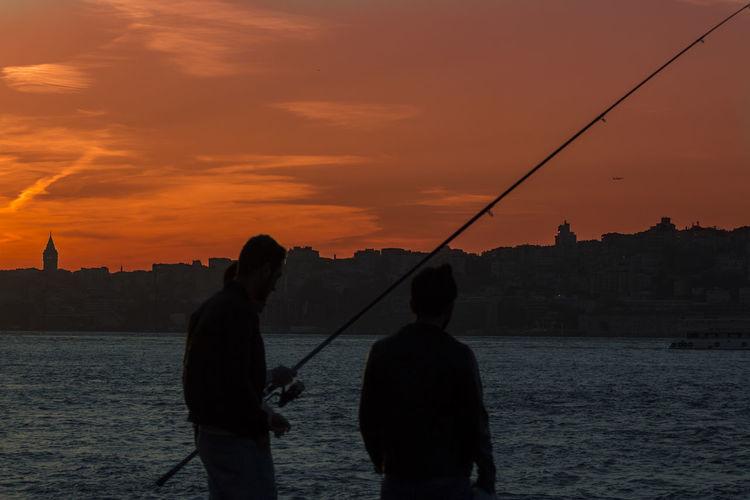 Adult Adults Only Fishing Fishing Rod Fishing Tackle Galata Tower Galatakulesi Galatatower Outdoors People Sea Silhouette Sky Sunset Sunsets Vacations Water Weekend Activities