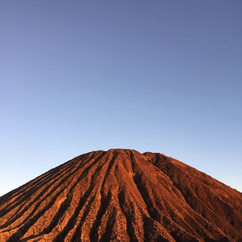 first light Valcano Bromo Bromo Mountain Sky Beauty In Nature Copy Space Blue Clear Sky Scenics - Nature No People Landscape Day Tranquility Low Angle View Land Field Nature Pattern Environment Agriculture Tranquil Scene Outdoors Growth