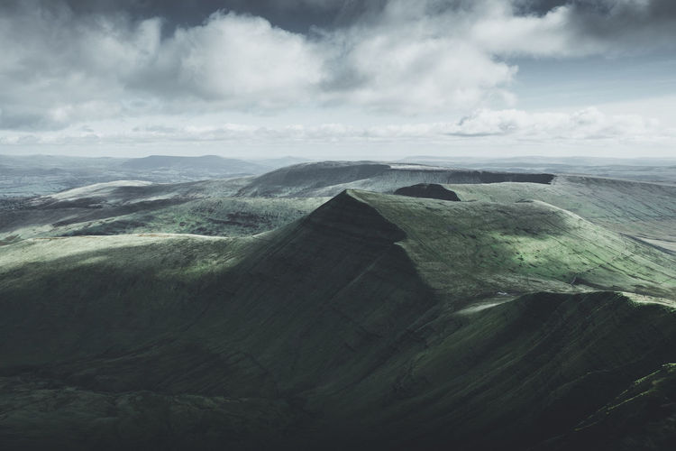 The Parc Cenedlaethol Bannau Brycheiniog (Yes! This is Welsh!) is one of three national parks in Wales. I hiked on top of the highest mountain (Pen y Fan - 873 m) of the Brecon Beacons and had this amazing view of the surrounding area. Location: Brecon Beacons, Wales Equipment: Fujifilm X-T2 + XF18-55 F2.8-4 Brecon Beacons Brecon Beacons National Park Green Color United Kingdom View Wales Wanderlust Welsh Beauty In Nature Cloud - Sky Cold Day Globetrotter Landscape Mood Mountain Nature No People Outdoors Peak Pen Y Fan Scenics Sky Tranquil Scene Tranquility Lost In The Landscape The Great Outdoors - 2018 EyeEm Awards