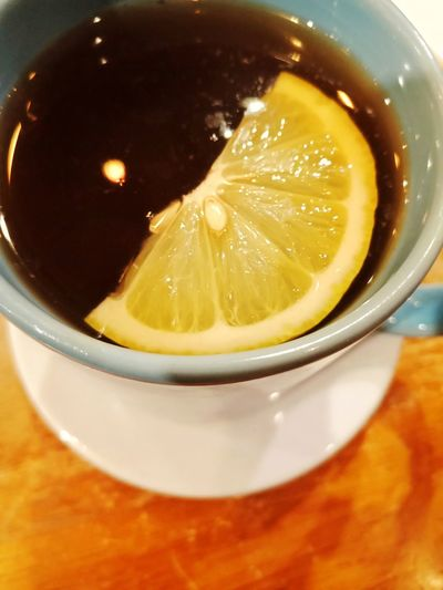 High angle view of lemon in glass on table