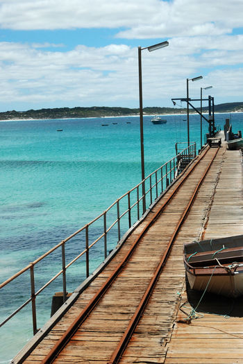 Scenic landscape in Kangaroo Island, Australia Australia Beauty In Nature Blue Water Boat Cloud - Sky Coast Coastline Day Horizon Over Water Island Jetty Lagoon Landscape Nature No People Outdoors Railing Scenic Scenics Sea Sky Tranquil Scene Water Waves, Ocean, Nature Wood Paneling