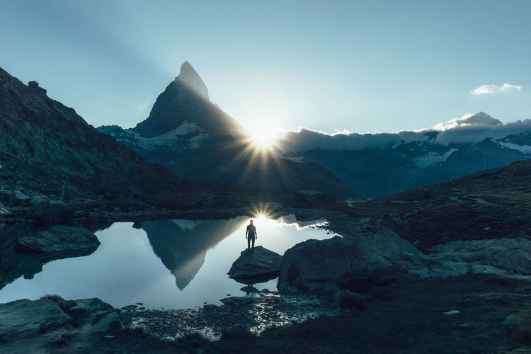 Man enjoying sunset in front of the majestic Matterhorn mountain in Switzerland Alps My Year My View Explore Exploring Famous Place Gornergrat King Of Mountains Matterhorn  Mountain Mountains Outdoorsman Peaceful Remote Suisse  Sunset Swiss Swiss Alps Swiss Holidays Swiss Mountains Swiss Nature Switzerland Toblerone Mountain Tranquility Zermatt Fresh on Market 2016