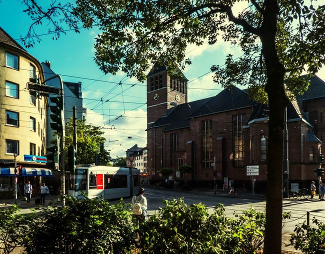 Bilker Kirche tram way City Cityscape City Life City Street City Tree Street Sky Architecture Building Exterior Built Structure Moving Red Light Street Light Tramway Tram #urbanana: The Urban Playground