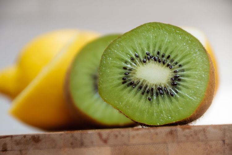 Close-up of kiwi and lemon slices on table