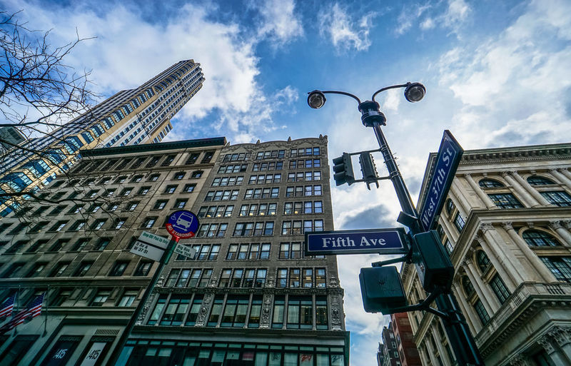 NYC (big apple) bites 5th Ave 5th Avenue 5th Avenue, NYC NYC NYC Photography New York New York City Tourist Attraction  Travel Architecture Building Exterior Built Structure City Cloud - Sky Communication Day Guidance Low Angle View No People One Way Outdoors Road Sign Sky Skyscraper Sony A6000 Street Name Sign Text Tourism Tourist Destination Travel Destination Travel Destinations