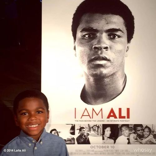 Check This Out taking photo with picture of his grandfather Mohamed Ali