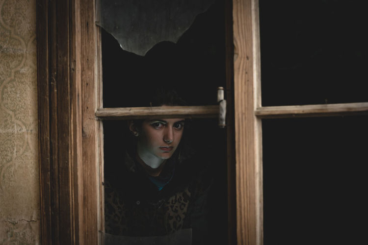 Georgian Georgian One Person Portrait Indoors  Wood - Material Window Adult Real People Young Adult Looking At Camera Women Standing Looking Front View Lifestyles Headshot Building Architecture Punishment Contemplation Dark