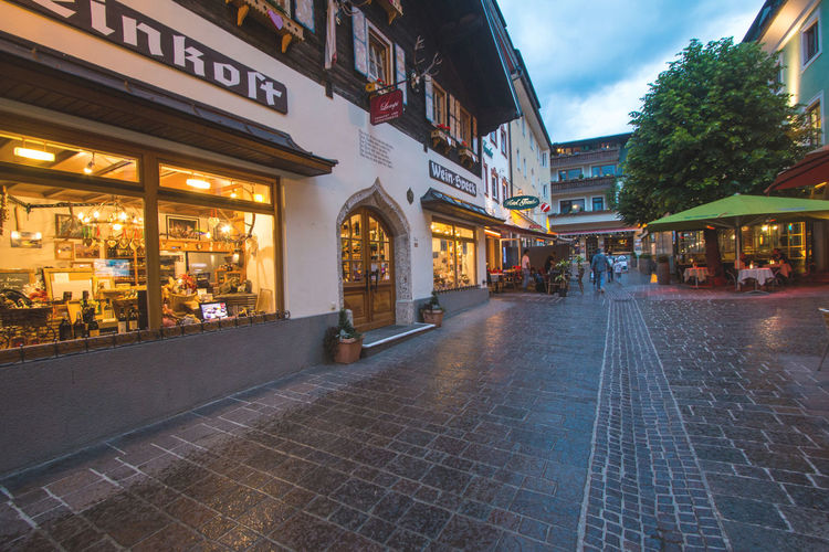 Street in Zell Am See town in Austria in the evening Austria Lights Shops Travel City Dusk Evening Illuminated Street Tour Tourism Town Zell Am See