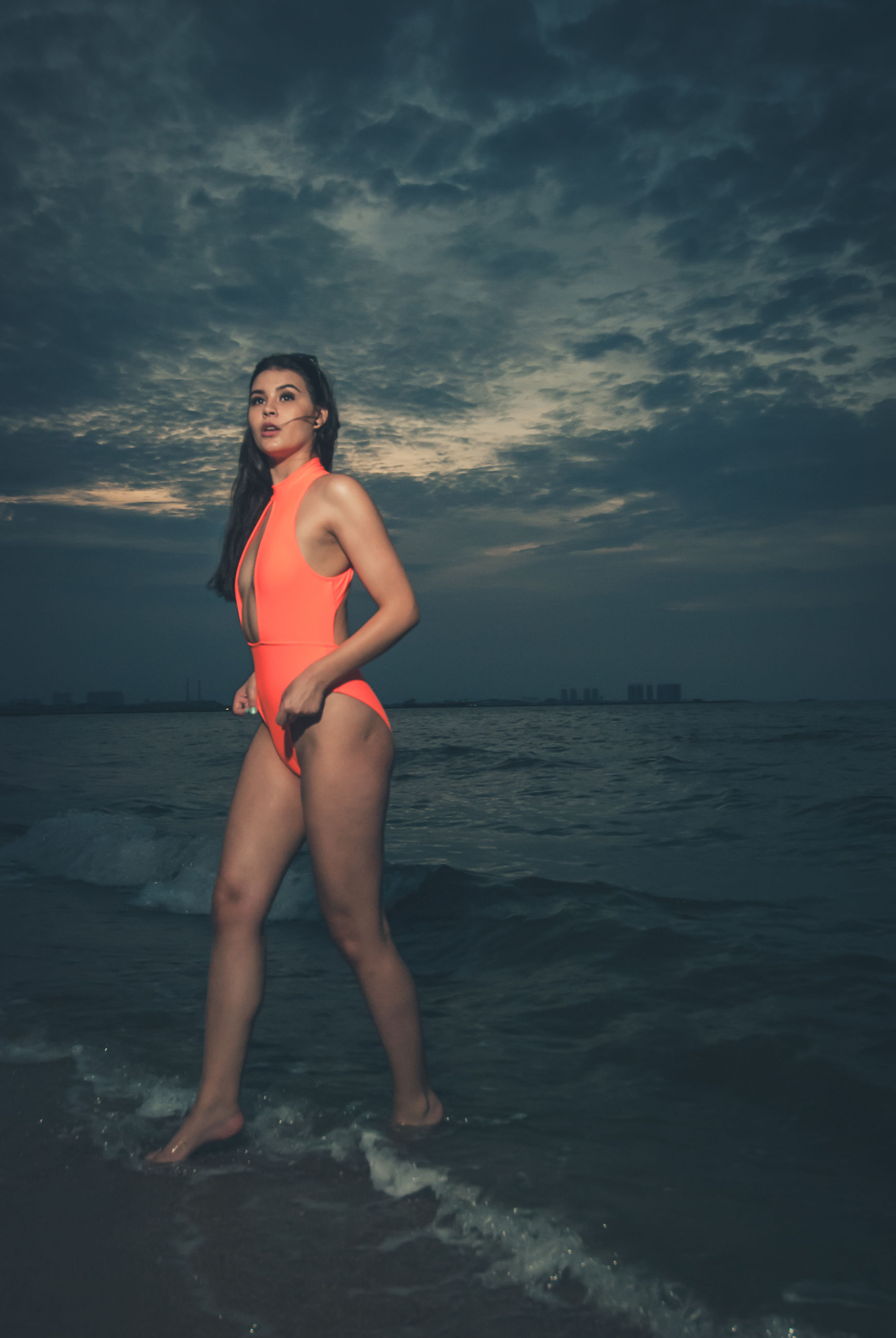 sky, sea, one person, water, cloud - sky, lifestyles, young adult, beauty in nature, real people, full length, swimwear, clothing, young women, nature, leisure activity, scenics - nature, sunset, women, horizon over water, beautiful woman, outdoors
