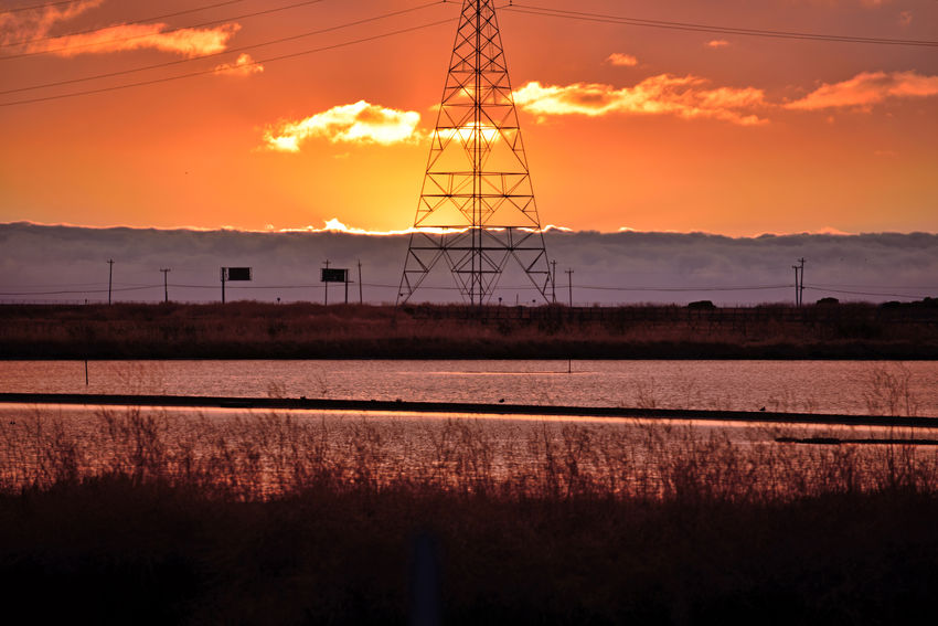 Sunset At Eden Landing 17 The Sun's Last Rays Eden Landing Ecological Reserve Wildlife Refuge Marsh Tidal Wetlands Scenic Salt Pond Lowtide  Mudflats Sunset Silhouettes Sunset Sundown Sunset Collection Sun's Glow Reflections Reflections In The Water Nature Beauty In Nature Nature_collection Landscape_Collection Power Pylon & Lines Telephone Poles & Lines Highway Signs Native Grasses Landscape_photography Fog Marine Layers! Foggy Tranquil Scene Horizon Over Water