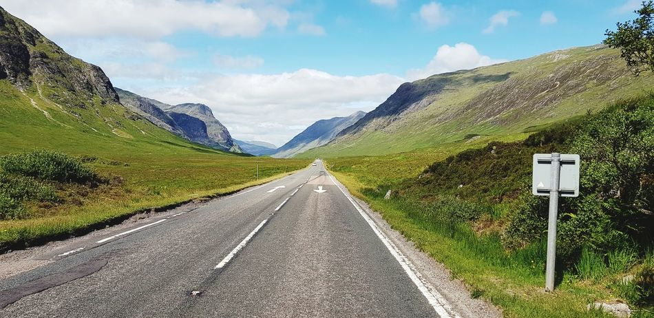 EyeEm Selects Summer Road Tripping Mountain Road Road Sign Rural Scene Sky Cloud - Sky Landscape Mountain Range