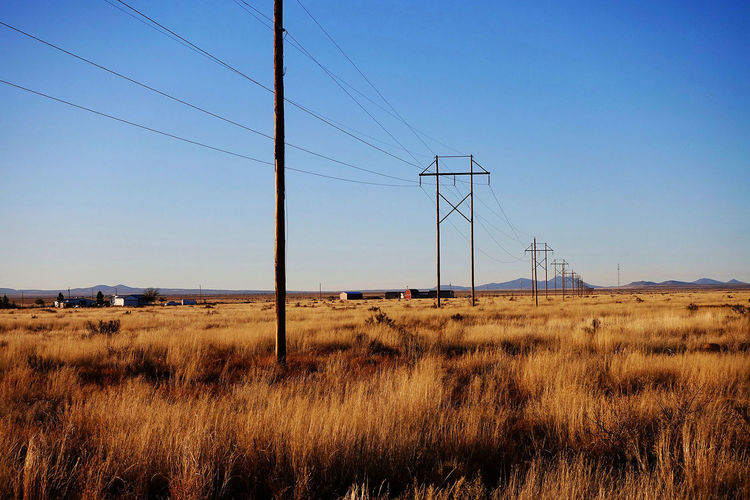 Flat land at Whitewater in the USA. Grass New Mexico USAtrip Blue Sky Buildings Day Flat Land Landscape Mountains No People Outdoors Power Lines Against Sky Power Poles Whitewater