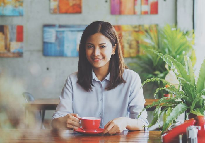 Asian woman in cafe Asian  Coffee Time Couple Woman Businessman Cafe Concept Dating #love #happiness Drink Idea Indoors  Lifestyles Real People Young Women