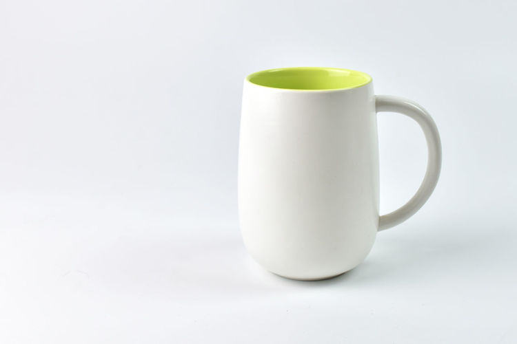 Close-up of coffee cup on white background