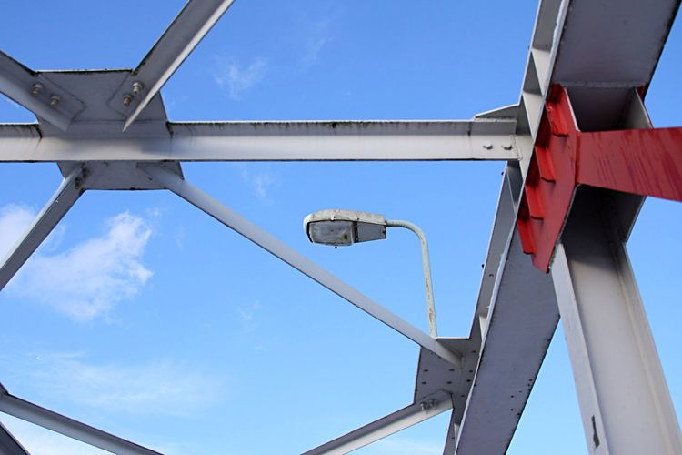 Architectural Detail Of Metallic Bridge Against Blue Sky
