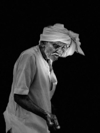 Old man Black Background One Person Studio Shot Indoors  One Animal Women Side View Adult Holding Portrait Waist Up Unrecognizable Person Three Quarter Length Profile View Real People