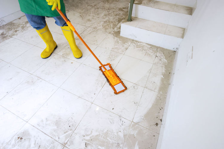 Low section of person working on floor at home